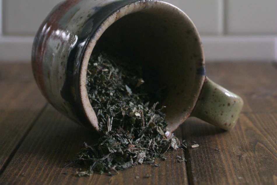 dried herbs spilling from mug