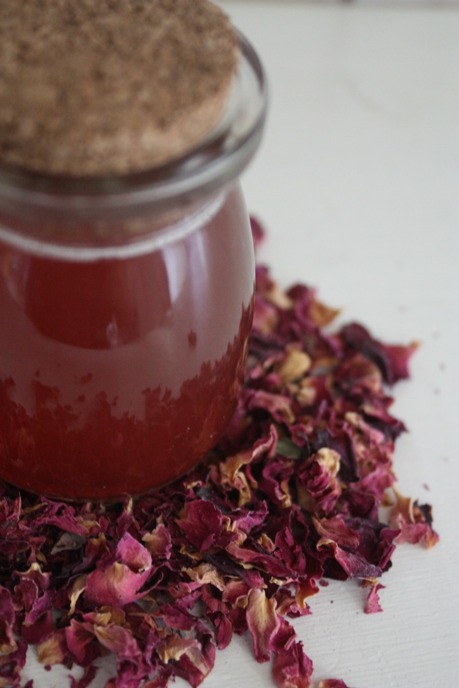 bottle of rose syrup and rose petals