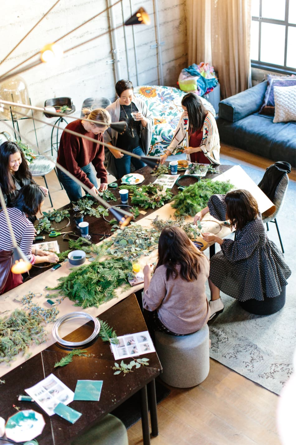 women gathered making things with herbs