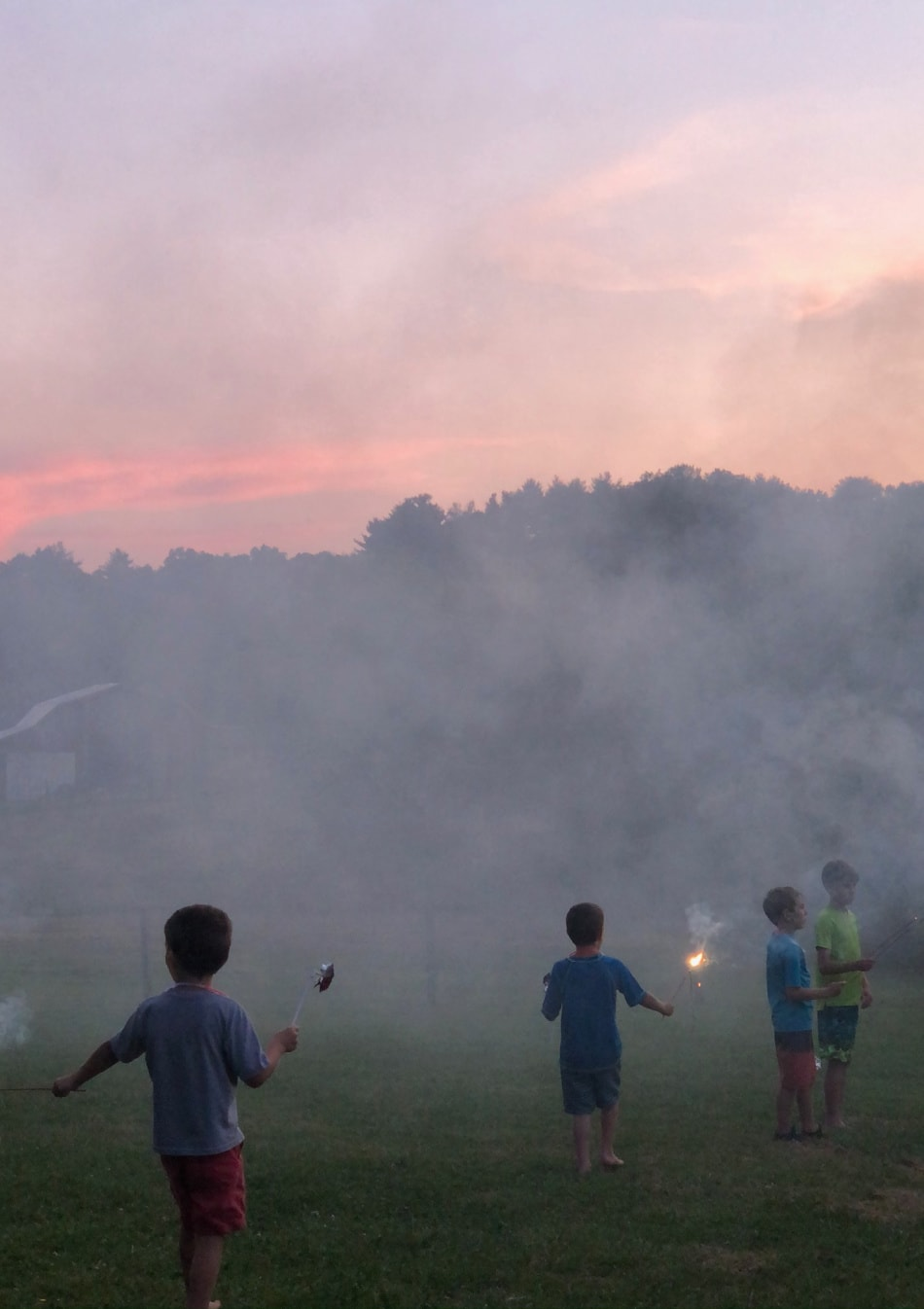 hazy field, sunset, and fireworks